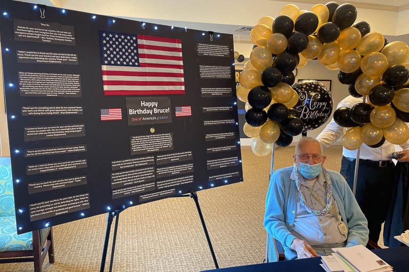 Senior citizen with birthday board