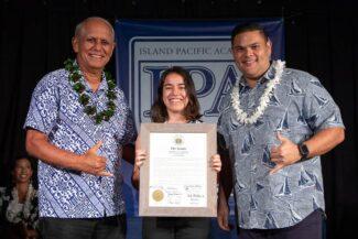 Haley Nakamura receives the Navigator Award from Senator Mike Gabbard