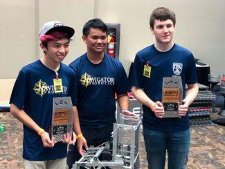 Nathan Okimoto '22, Ryan Corpuz '22, and David Pavlicek '22 receive their awards