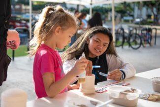 Students glaze ceramic pots