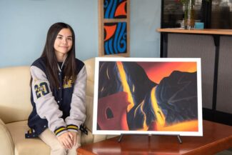 Lina Finley with her artwork