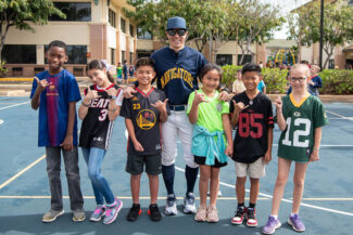Students and teacher dressed up for Sports Day